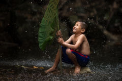 Thai child cheerful with playing water splash stock images