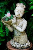 Thai child statue in a garden Stock Photography