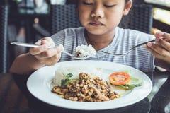 Thai children eating in restaurant Royalty Free Stock Photos
