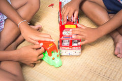 Thai Children playing with toy fire car set,general Stock Images