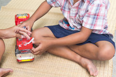 Thai Children playing with toy fire car set,general Stock Image