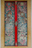 Thai and chinese art paint mural on multi colors door Stock Image
