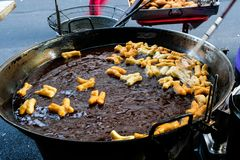 The Thai Chinese Deep Fried Donut Was Being Made In The Big Wok. Those dough are meant for this big wok filled with hot oil, what a faith … They fluff and stock image