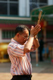 Thai Chinese Man praying Royalty Free Stock Images