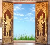 Thai church door. And blue sky stock images