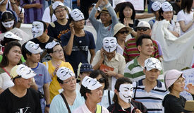 Thai citizens listen to Rally speakers. BANGKOK, July 14: Anti-government protestors supporting the white-mask movement against corruption in the Yingluck Stock Images