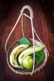 Thai classic fruit basket. Thai classic tropical fruit in bamboo basket isolated on wooden background Royalty Free Stock Photos