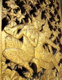 Thai Classical literature on wall gold stucco Stock Photos