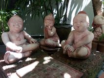 Thai clay dolls are smiling in the garden decoration Stock Photos