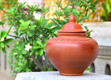 Thai clay pot of water for drink. On nature background Stock Photo