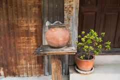 Thai clay water pot with dipper made from coconut shell Royalty Free Stock Photos