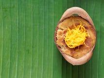 Thai coconut custard pudding dessert, Maw Gaeng, in clay pot on banana leaf background. Thai coconut custard pudding dessert, Maw Gaeng, topped with golden royalty free stock photos