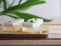 Thai Coconut jelly on wooden dish. Popular Thai desserts royalty free stock photos