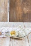 The thai coconut munchkin sweet taste delicious on wood Royalty Free Stock Photos