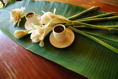 Thai coffee time. This set is prepare for coffee time.it is decorated with banana leaf and white flower Royalty Free Stock Photo