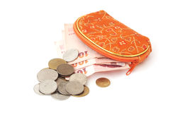 Thai coins and banknote with opened orange purse Royalty Free Stock Image