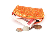 Thai coins and banknote with opened orange purse Stock Images