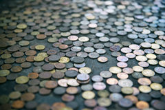 Thai Coins Left at Buddhist Temple Stock Images