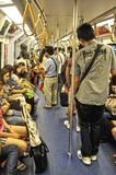 Thai commuters in a train. Thai commuters in an MRT train in Bangkok, Thailand, on the 6th of August 2011 Stock Photos
