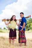 Thai costume and ancient musical instrument Stock Images