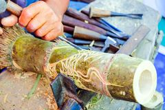 Thai craftsman and art bamboo pattern. Thai craftsman uses chisel to carve bamboo pattern, Carving is one of the inherited knowledge of the Thai people Royalty Free Stock Photography