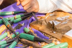 Thai Craftsman carving wood making. Wooden handicraft arts object Royalty Free Stock Images
