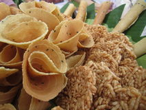 Thai crispy golden curl and rice cracker, thailand traditional snack called Thong Pab and Khaotan royalty free stock photo