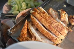 Thai crispy pork on a plate stock images