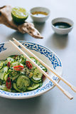 Thai cucumber salad with sesame and chili stock image