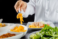 Thai cuisine. Chef making thai cuisine, Rice Mixed with Shrimp paste in restaurant royalty free stock image