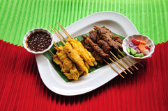 Thai cuisine,Chicken Satay,Beef Satay. Malaysian chicken satay with delicious peanut sauce, one of famous local dishes Royalty Free Stock Images