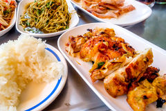 Thai cuisine. Grilled pork, Grilled chicken marinated in curry powder, Thai papaya salad also known as Som Tum from Thailand and Spicy Bamboo Shoot Salad royalty free stock image