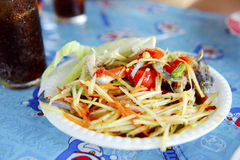 Thai cuisine - hot and spicy papaya salad Royalty Free Stock Photo