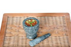 Thai cuisine-Nam Prik Gapi or Shrimp Paste Chili Dip. In mortar and pestle on wooden background Royalty Free Stock Images