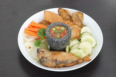 Thai cuisine-Nam Prik Gapi or Shrimp Paste Chili Dip. In mortar serves with fried mackere fish and various vegetables Royalty Free Stock Images