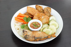 Thai cuisine-Nam Prik Gapi or Shrimp Paste Chili Dip. Serves with fried mackere fish and various vegetables Stock Photos