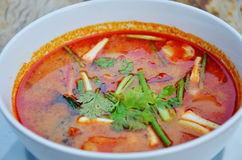 Thai cuisine name Tom yum goong is prawn and lemon grass soup with mushrooms Stock Photos