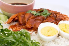 Thai cuisine red pork over rice with boiled egg Stock Images