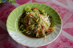 Thai cuisine Som Tum or thai food fruit spicy green papaya salad. With pickled fish and Turkey berry or Solanum torvum and small eggplant and small tomato and stock photo