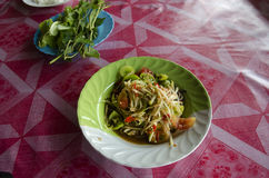 Thai cuisine Som Tum or thai food fruit spicy green papaya salad. With pickled fish and Turkey berry or Solanum torvum and small eggplant and small tomato and royalty free stock photography