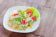 Thai cuisine spicy pork salad on wood background or Yum Moo Yor Royalty Free Stock Photo