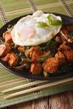 Thai cuisine: Stir-Fry Gai Pad Krapow chicken on a plate close-u Stock Photography