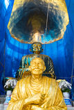 Thai culture. The golden monk statue with trust in Thailand Royalty Free Stock Image