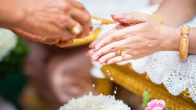 Thai culture, hand of a bride receiving holy Stock Photos