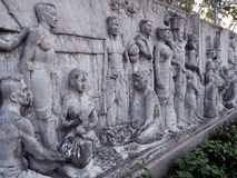 Thai culture stone carving on a wall Royalty Free Stock Photos