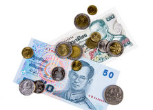 Thai currency cash. Banknotes and coins isolated on white background Royalty Free Stock Photography