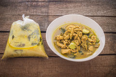 Thai curry in plastic bag and bowl Royalty Free Stock Photo