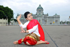 Thai Dancing. BANGKOK, THAILAND - OCTOBER 2: An unidentified woman performs a Thai traditional dance during a parade of people from the northern territory of royalty free stock photos