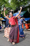 Thai Dancing. BANGKOK, THAILAND - OCTOBER 2: An unidentified woman performs a Thai traditional dance during a parade of people from the northern territory of royalty free stock images