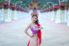 Thai dancing girl with northern style dress in temple Royalty Free Stock Images